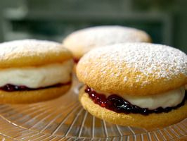 Powder Puffs Cookies with Raspberry jam and vanilla flavored whipping cream filling. I bet these would be tasty using lemon cookies.