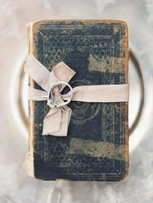Vintage welcome table decor includes an antique guest book tied with an ivory ribbon.| Lewis & Clark College in Portland, OR