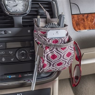 Patterned fabric cell phone holder for car dashboard is also a USB car charging station. The perfect auto dash organizer for charging cords, sunglasses, iPhones and Android phones. High Road has a full assortment of cell phone holders for cars.