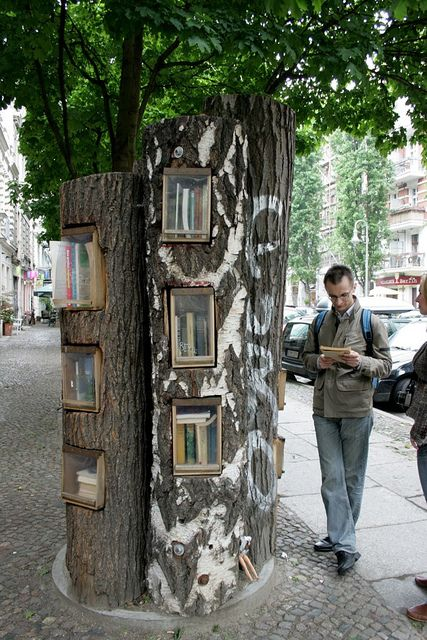 An exchange bookshelf in Berlin. You put a book on the shelf and take one out. This is so cool! I love how they're in tree trunks too.