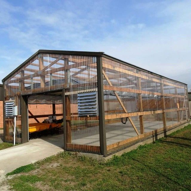 repurposed old steel covered pole barn into a greenhouse