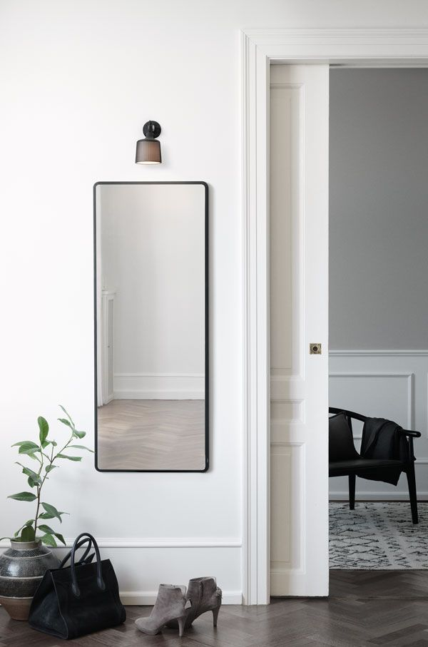 Small wall spot light designed by Vipp, made from powder coated perforated aluminium. Love the placement of the light about this minimalist hallway mirror.