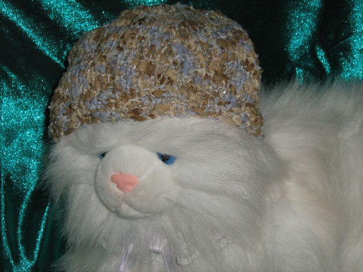 Grumpy toy cat modelling one of my knitted hats...........