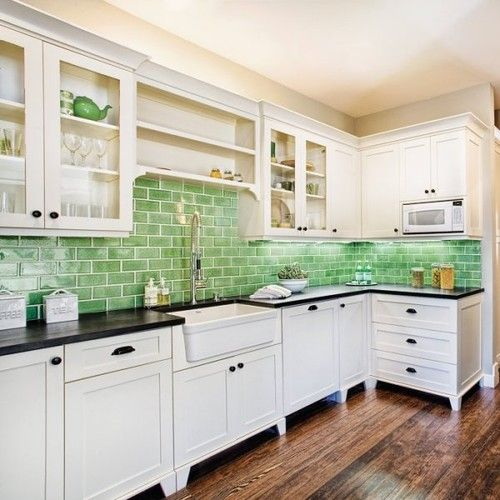 Love, love, love the green subway tile splashback with the black benchtop and white cupboards. Now if only I could find these in Australia.