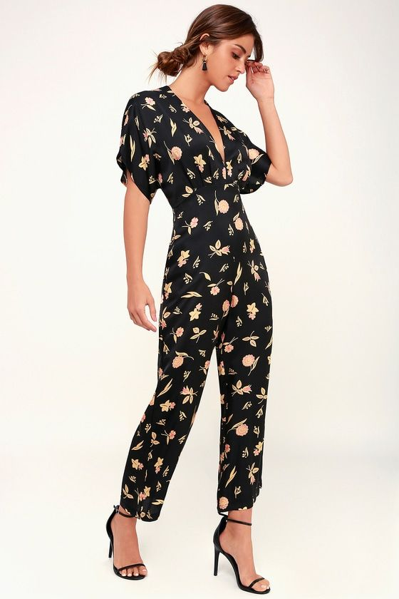 9ccc835765e1 The Capulet Remy Black Floral Print Short Sleeve Satin Jumpsuit is party  ready! A golden yellow floral print adorns the relaxed bodice and long