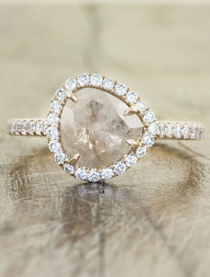 Unique pink diamond engagement ring with diamond halo in rose gold by Ken & Dana Design.