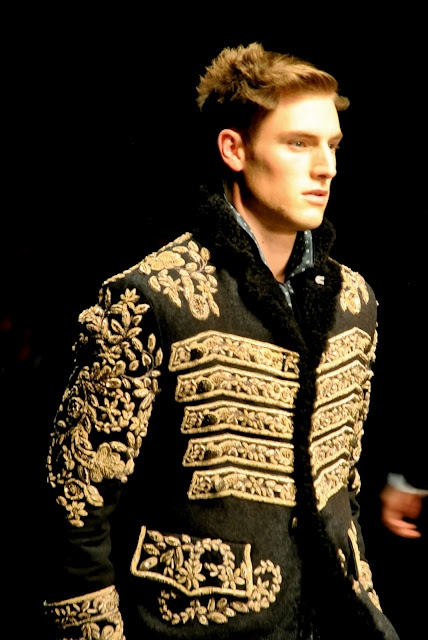 Designer: Dolce and Gabbana.  This jacket with white shorts would be amazeballs.