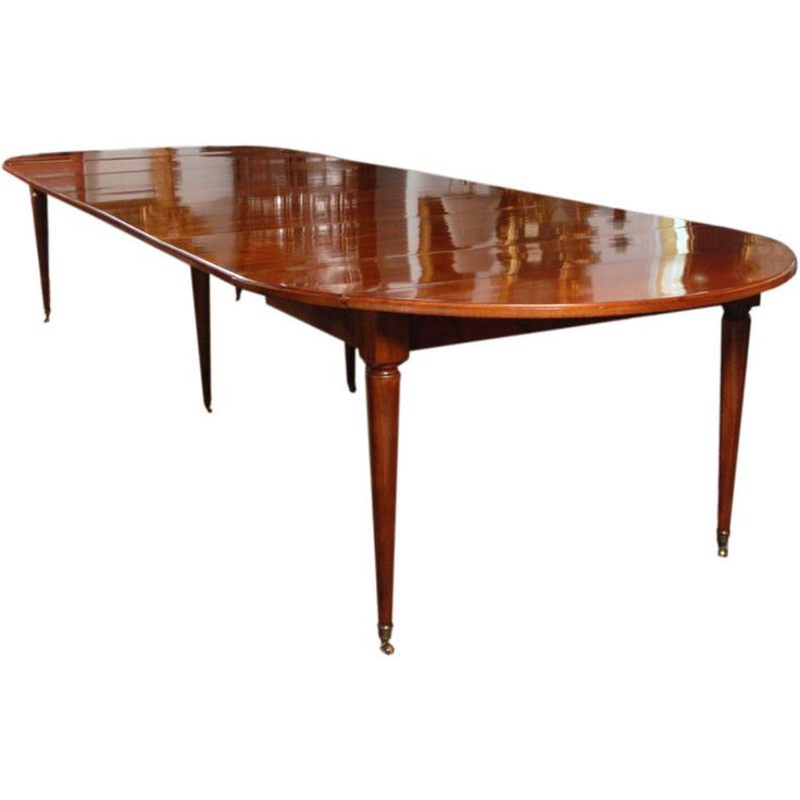 A Louis XVI Faded Mahogany Round Extending Dining Table