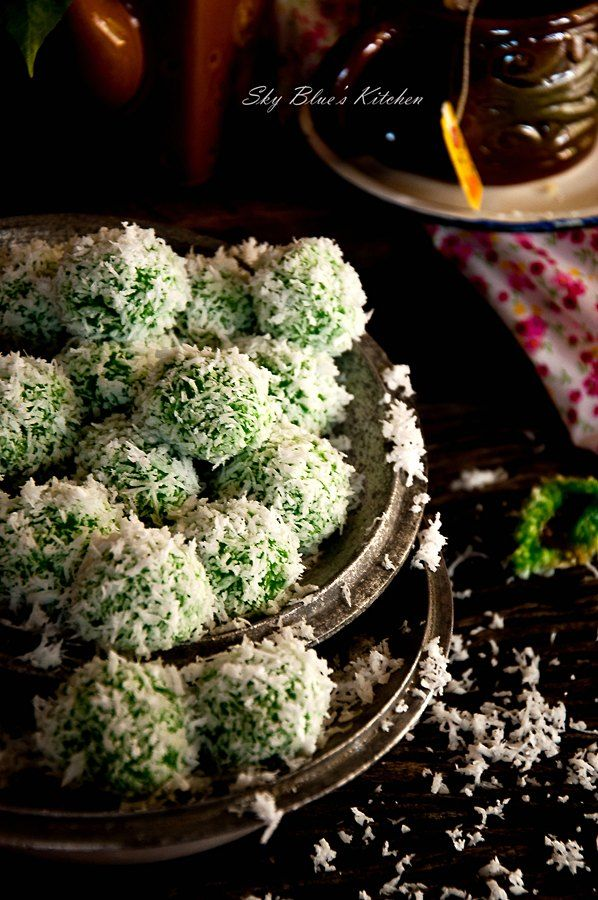 ONDE-ONDE. ( Tradisional snacks in Indonesia. Can find it at traditional market with low price. On the cake, there are green beans, so tasty and sweet. These cute little pastries are infused with pandan (screwpine leaf) juice and filled with palm sugar and then rolled in with some fresh grated coconut. The palm sugar that's in it literally bursts in your mouth when you take a bite. They are sweet and delicious ).