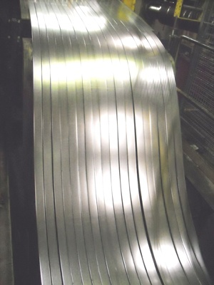 "High Carbon Spring Steel being slit on our 52"" slitter!"