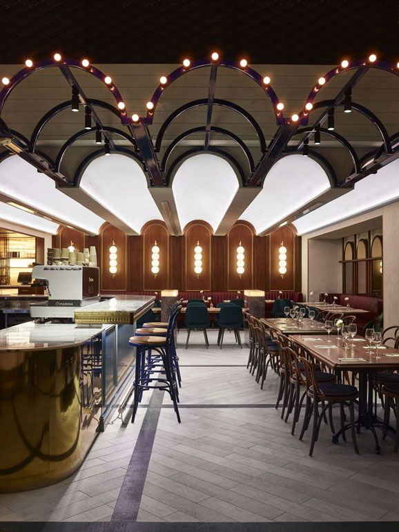 Up-lighting highlights the ceiling creating a glow effect.  M&G Café and Bar | The Star | Designed by Luchetti Krelle