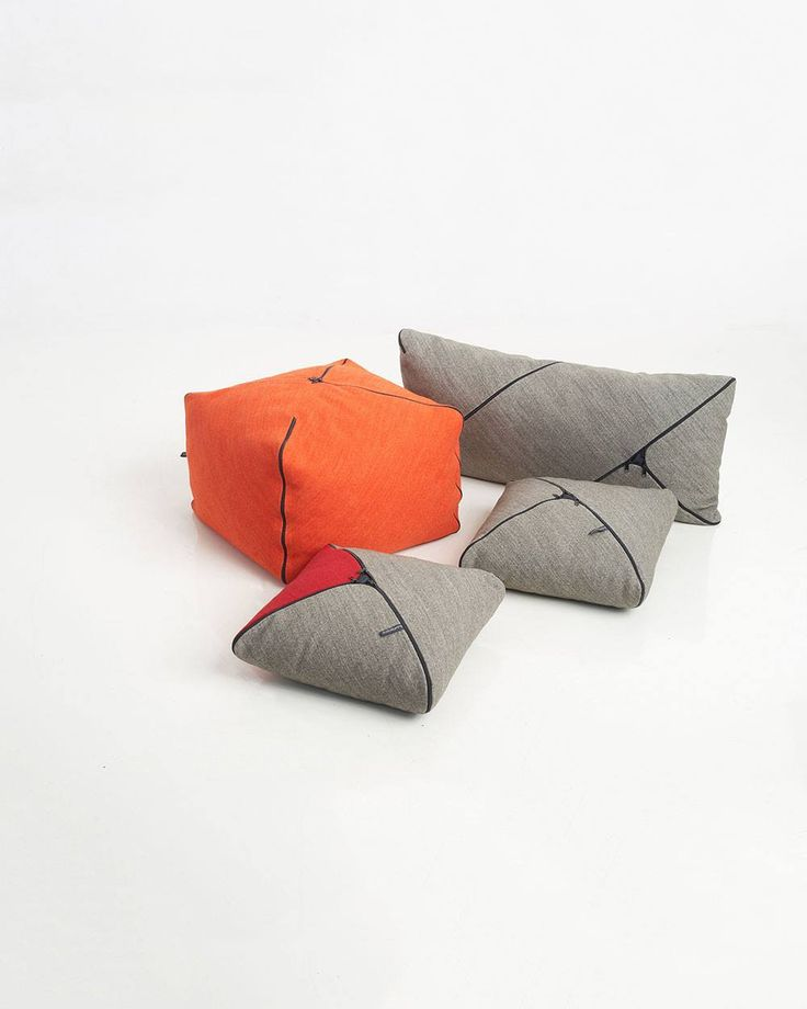 Puf NYKRAM A family of cushions and poufs in various sizes, which are made from a rectangular piece of fabric with a diagonal zipper. The zipper operates as a connector for the two sides and as an embellishment. Inside, the silicone filling is evenly dispersed and located in a pillowcase of contrasting color.