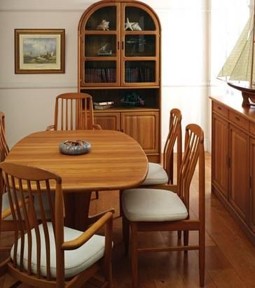 Beautiful Dining Room With A Table And Wooden Cabinet Lamp