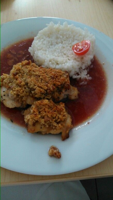 Chicken steak with cherry sauce,crushed nuts and rice