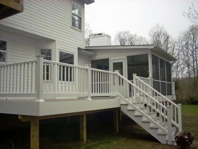 Vinyl #deck with screened #porch, AZEK Building Products slate grey flooring, and white PVC railing.