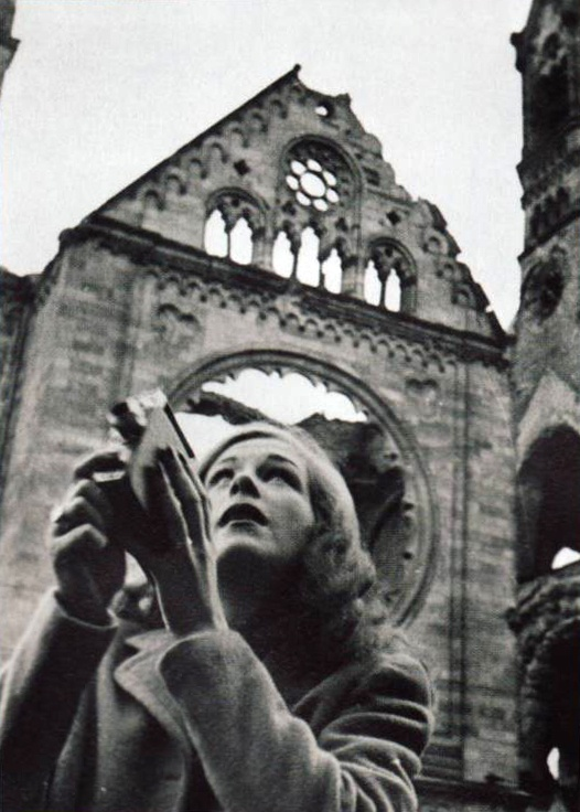 German actress and singer Hildegard Knef shoots her Kodak 8mm camera amidst the…