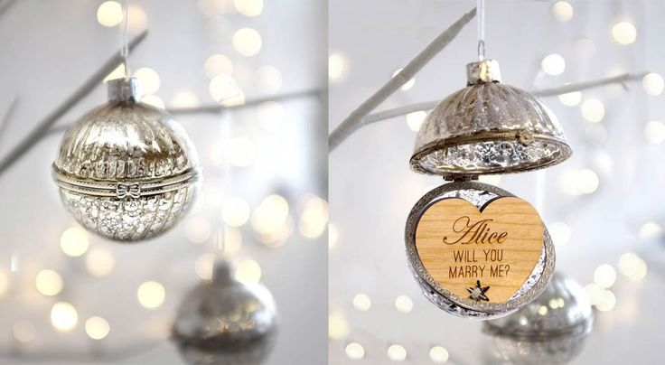 A Christmas proposal with a personalised bauble