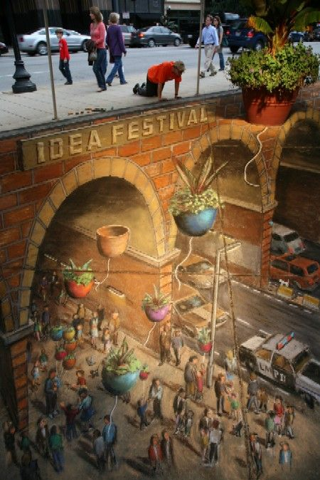 Masterful sidewalk painting by Julian Beever appears to be 3 dimensional but it is actually flat.....Incredible!