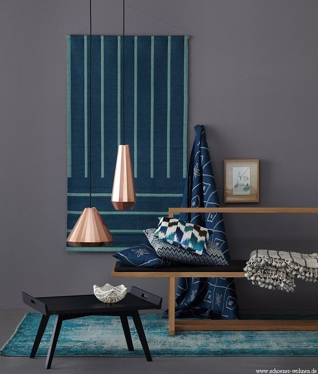 Petrol blue/grey walls look great with copper pendant shades and accessories