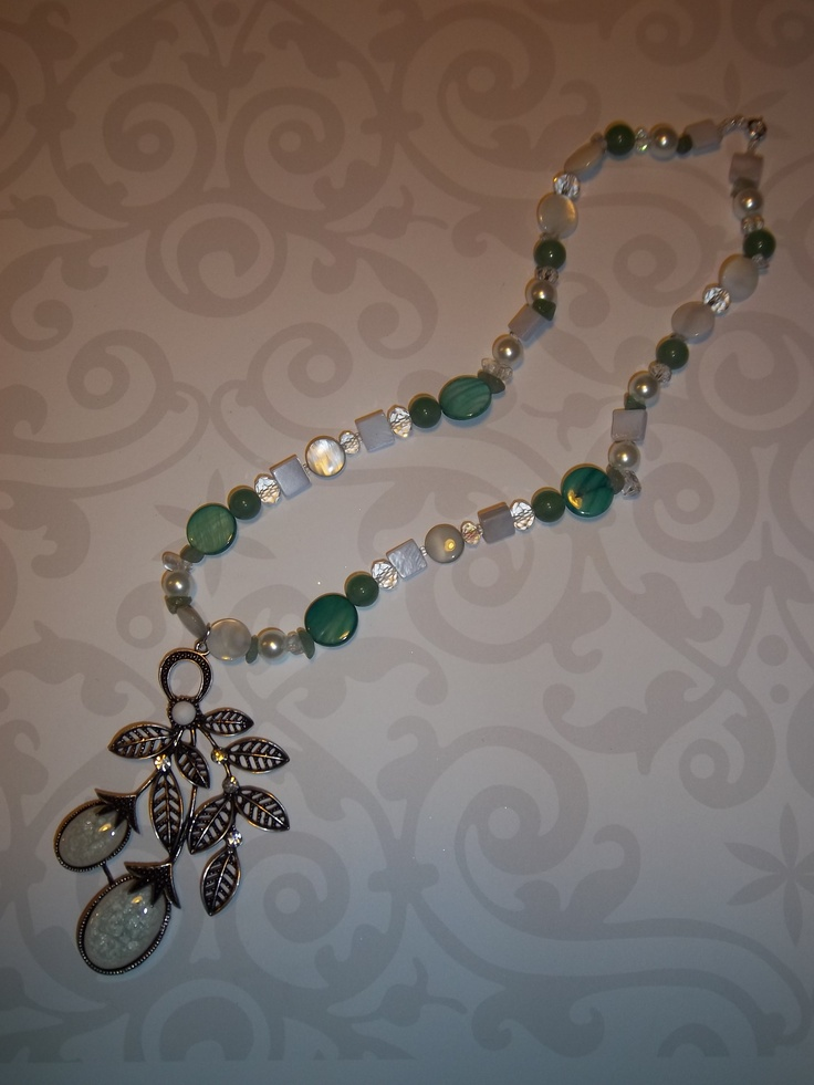 A very pretty necklace in white and sea green perfect to wear with a dress to a wedding