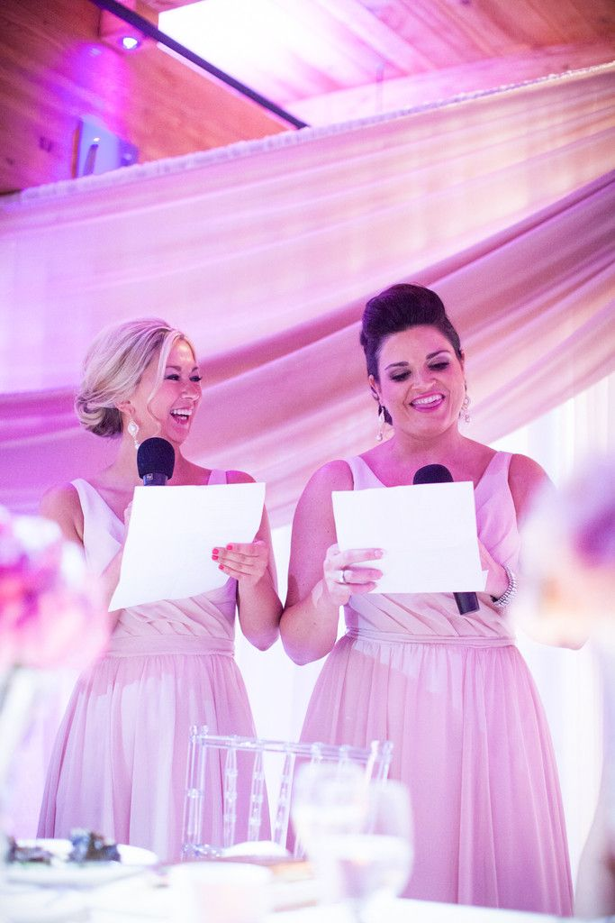 Two Bridesmaids Giving A Toast To The Bride