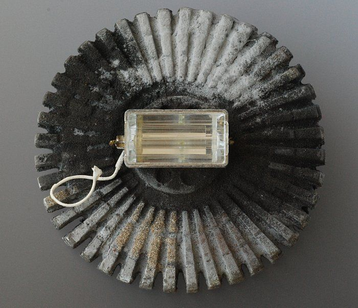 Julia Middleton - Artefact 1  brooch (Found Object, Resin, Iron Powder, Copper, Sterling Silver, Steel Pin)