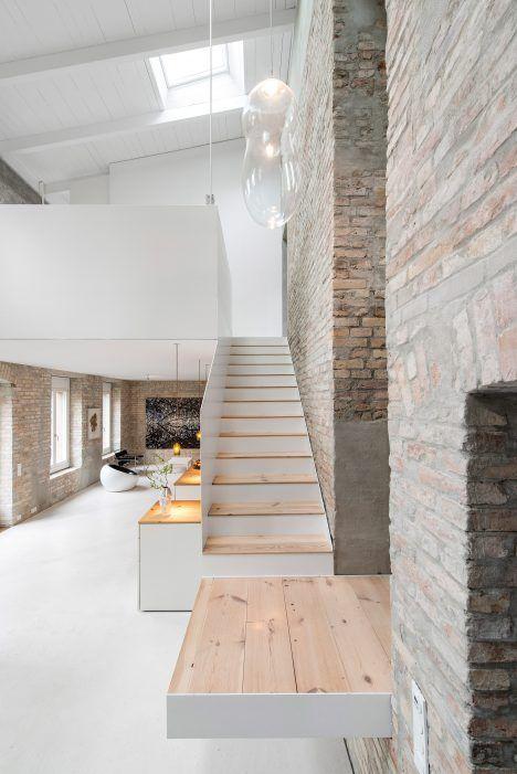 Asdfg Architekten converts former miller's house into contemporary home