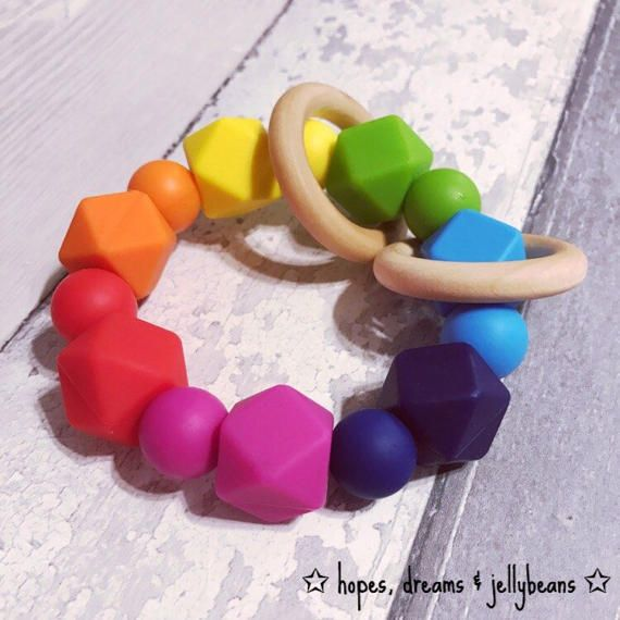 Rainbow keepsake silicone teething rattle teether