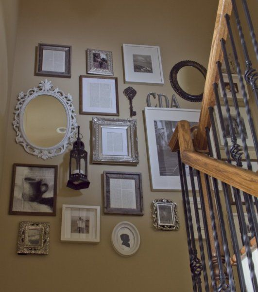 great #picture #display - notice framed drawings, pages from book, b/w pics with ornate and rustic frames.