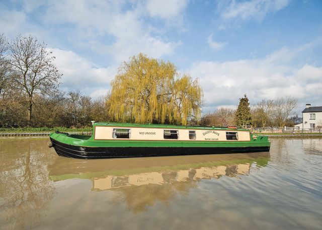 Wild Lavender, one of our narrowboat hire fleet leaving the top lock at Calcutt  #narrowboat #canal #holiday www.calcuttboats.com