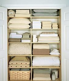 beautifully organized linen closet with twice as many shelves as mine - coincidence???