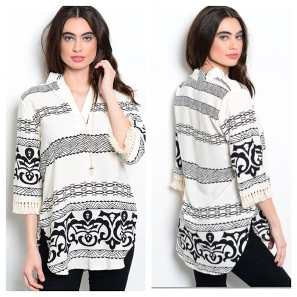 """Black and white fringe blouse (S M L) Black and white fringe blouse  S: L 31"""" B 36""""• M: L 31"""" B: 38""""• L: L 32"""" B 40"""" Materials- 100% polyester NWOT. Brand new without tags. This top has no stretch, but it is slightly oversized. There are small slits on the bottom of each side and the sleeves have fringe.  Availability- S•M•L • 1•2•1 PLEASE do not purchase this listing. Price is firm unless bundled. No trades Tops Blouses"""