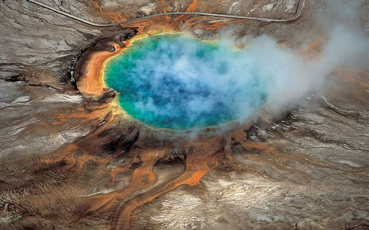 Yellowstone National Park's Grand Prismatic hot spring. A new University of Utah study reports discovery of a huge magma reservoir beneath Yellowstone's previously known magma chamber.