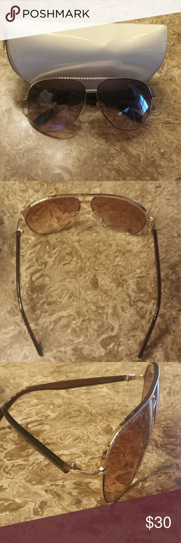 Jessica Simpson sunglasses Very nice aviator style.  Gold frame. No scratches. Comes with case. Jessica Simpson Accessories Sunglasses