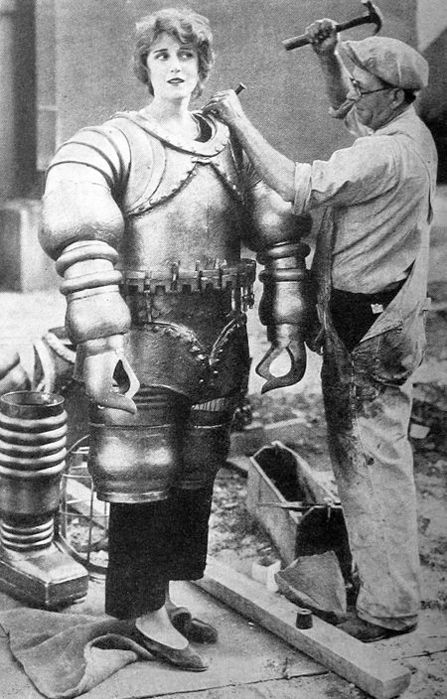 1929    Jane Daly getting into costume for The Mysterious Island, 1929. The film is an adaptation of Jules Verne's L'Île mystérieuse (The Mysterious Island), published in 1874.