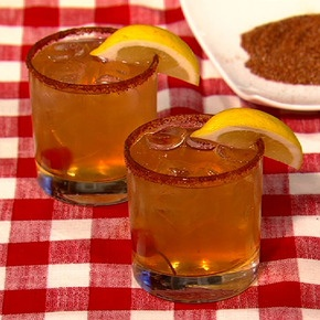 LOW N' SLOW:  For the Whiskey Sour:2 ounces bourbon1 ounce fresh lemon juice1 ounce superfine sugarSplash of waterLemon wedge and maraschino cherry (for garnish)For the Barbecue Rub Rim:1 tablespoon salt1 tablespoon chili powder1 tablespoon paprika1 tablespoon coriand