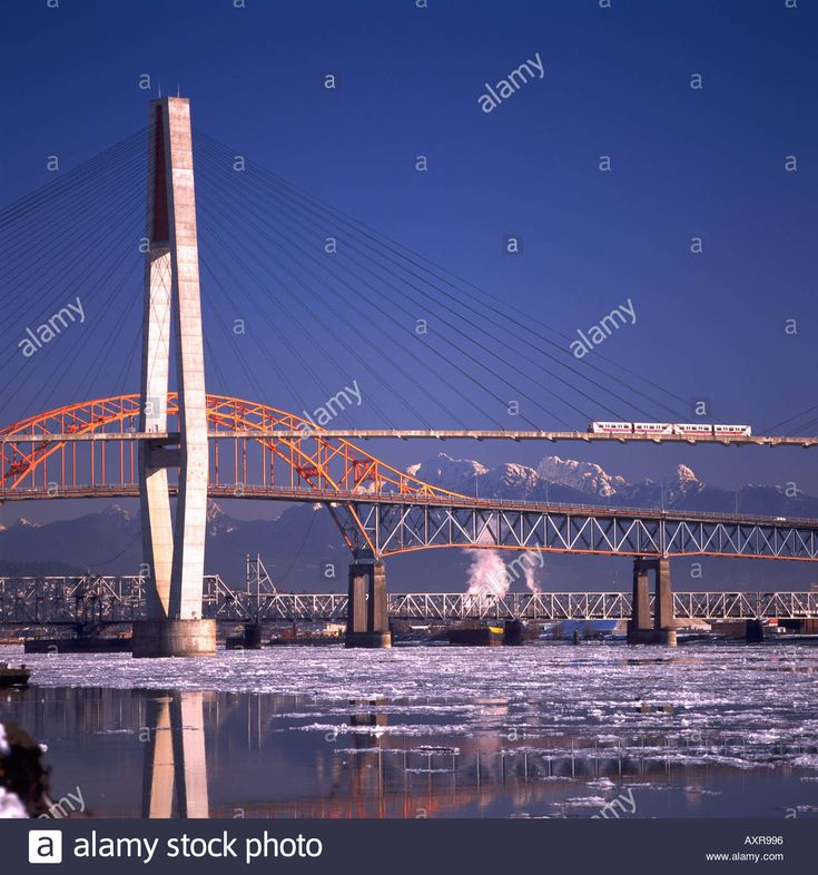 Bridges over Fraser River, New Westminster to Surrey, BC, British Columbia, Canada - Skytrain on SkyBridge, Pattullo Bridge Stock Photo