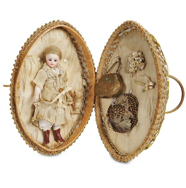 All-Bisque Mignonette with Painted Brown Boots in Wicker Egg Presentation. French,circa 1880.