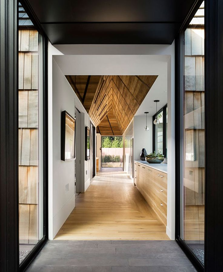 Underhill Residence by Bates Masi Architects | Photo by Michael Moran: THE HOME'S…  design draws upon the native Quaker aesthetic of simplicity, humility, and inner focus with its shingle-clad, pitched roof structures kept modest in size – each one turning inwards to its own garden courtyard.