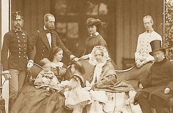 The only photo of Sissi with her family -in -lawFrom left: Emperor Franz-Josef,his brother Maximilian,Empress Elisabeth(Sissi) with her children Rudolf and Gisela,Archduchess Sophie her mother-in-law , behind her Princess Charlotte (wife of Maximilian),Archduke Louis-Viktor and with the hat Franz-Karl, Sissi's father-in-law.