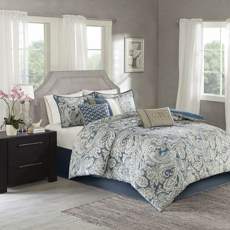 The Madison Park Gabby Comforter Set mixes a classic design with a contemporary color scheme to give you a charming bedding collection. The comforter features a classic paisley pattern that is perfectly contrasted against a rich, vibrant blue background. Three decorative pillows follow the same top of bed color scheme of blue, beige, and ivory to pull together the entire collection. Two shams and one bed skirt are included with the comforter and three decorative pillows to complete this set.