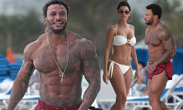 David McIntosh enjoys day at the beach with bikini-clad Nicole Murphy