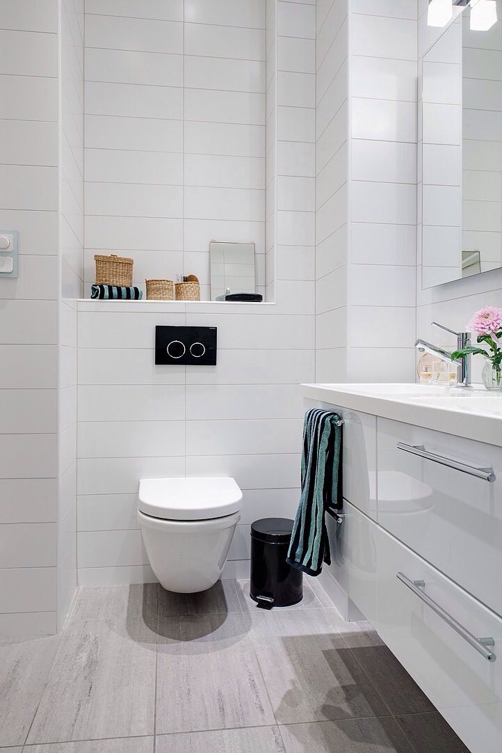 Gray Rectangle Floor Tiles With White Stacked Tiled Wall, White Vanity And  Fixtures.