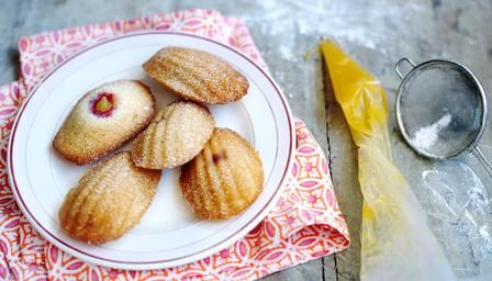 Madeleines with Lemon Curd  from Rachel Khoo of Little Paris Kitchen, given to her by Frankie Unsworth. It's a fussy recipe but, one bound to impress the fussiest guests at tea. This recipe for madeleines à la crème au citron can be made in advance and then baked in time for tea: madeleines should always be eaten fresh from the oven. _ http://www.bbc.co.uk/food/recipes/madeleines_with_lemon_65371