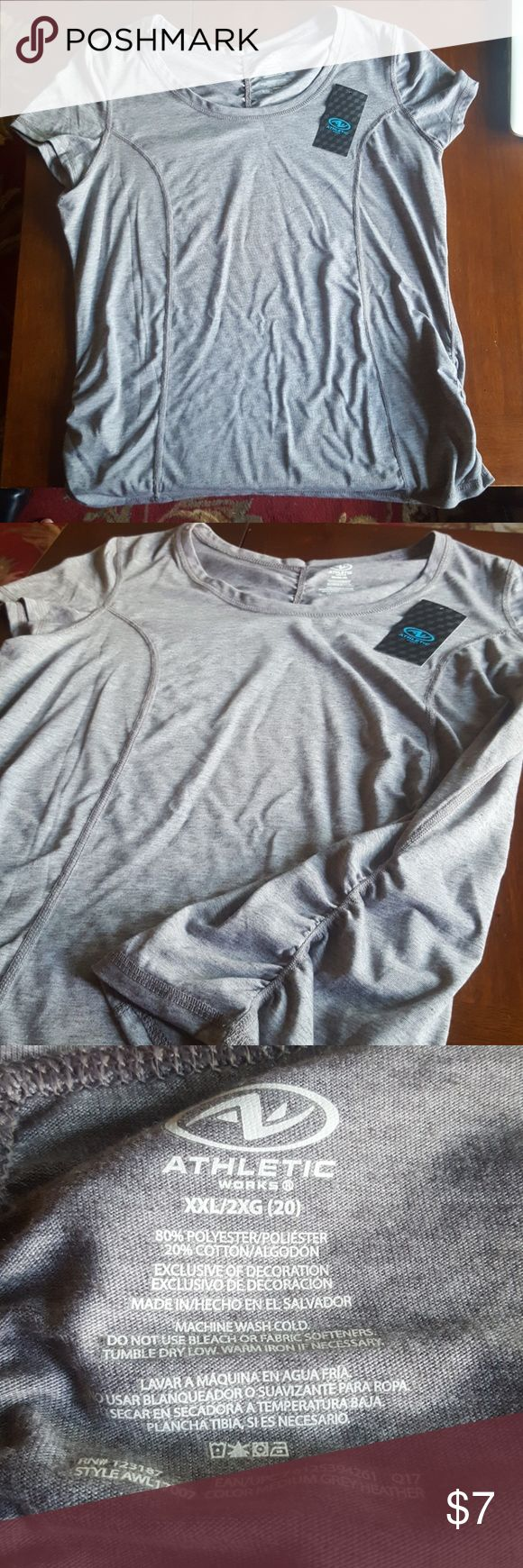 Heather Gray Athletic 2X T-shirt. Heather Gray Athletic 2X T-shirt. Gathers on both sides. New never worn. Runs a bit on the smaller side. Excellent condition. Size equals 20. 80% Polyester, 20% Cotton. Moisture Wicking to keep you dry and cool. Athletic Works Tops Tees - Short Sleeve