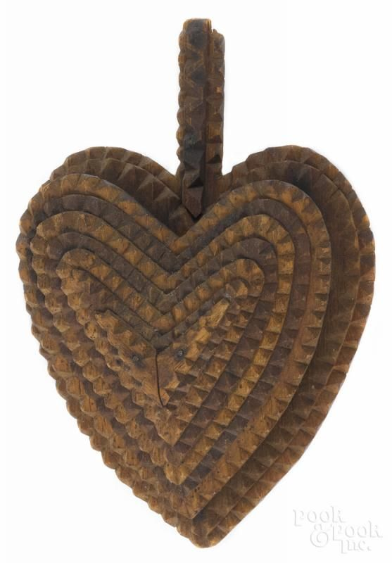 Tramp art carved heart-shaped wall pocket, ca. 1900, 7'' h., 5'' w. - Price Estimate: $40 - $60