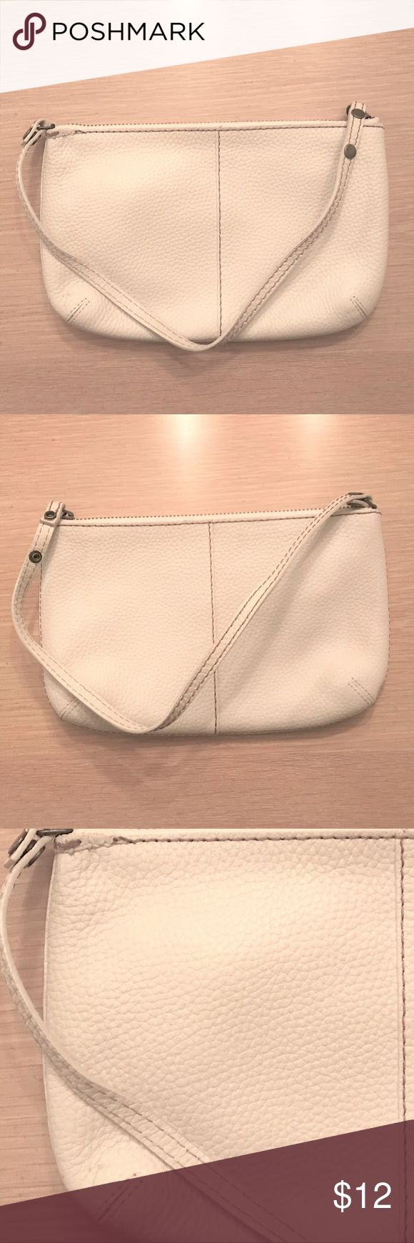 GAP Off-White Zippered Handbag This is an off-white handbag by GAP. It has a zipper to close at the top, opened by pulling the bag's strap. The inside has a zippered pocket and white fabric with black polka dots. It is in mint condition except for four very small pink spots inside, see last photo. GAP Bags Clutches & Wristlets