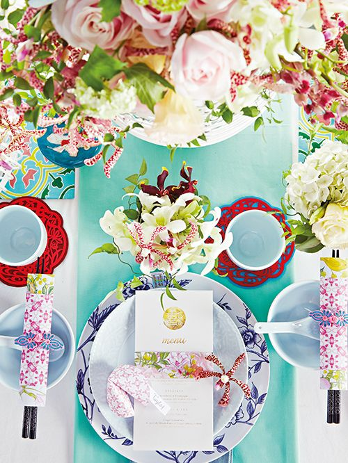 Exotic orchids and other blooms, as well as motifs paired with elegant dinnerware ensure a feast for the eyes - and the appetite. www.herworldplus.com/weddings/ideas-we-love/6-ways-have-modern-peranakan-inspired-wedding