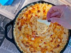 It's Cinco De Mayo, the official kick off to spring and summer and a great  reason to celebrate. What is a fiesta without a fiery cheese dip? Chips and  dip are a necessity when enjoying margaritas and Mexican liberation! If you  do not like a kick with your dip, we suggest using regular pimento cheese  in place of fiery in the dip to tone it down. This cast-iron dip is great  for entertaining and your guests will be begging for more!     1. Crumble the chorizo into a cast-iron skillet…