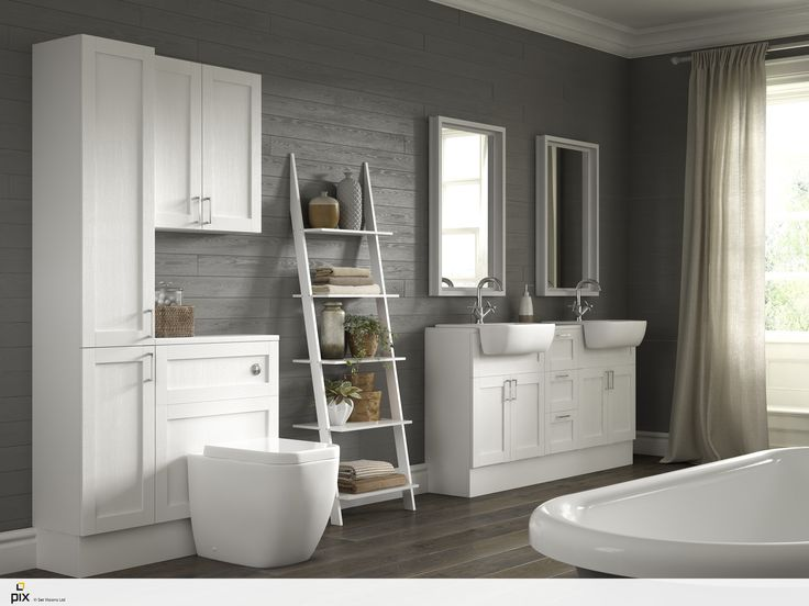 This White Shaker Bathroom is a set in a period open plan wash-room using contemporary interior design finishes. The painted dark grey clad walls looks great against the white fitted furniture. Double sinks are ideal for families while the open shelves hold quirky ceramics and earthenware pottery. Free standing bath with large windows which are softened with off white sheer curtains. Interior design inspiration by http://www.setvisionspix.co.uk/
